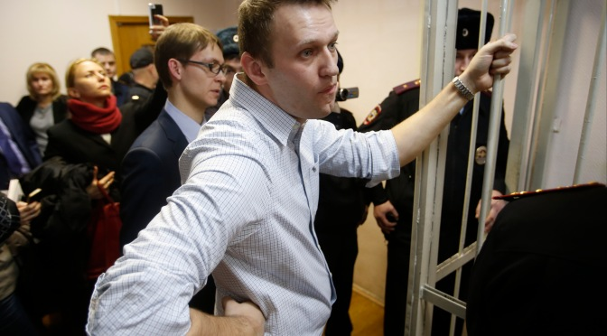 Putin critic Aleksei Navalny arrested at rally after fraud sentence