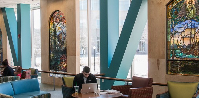 Students share thoughts on library's religious stained glass windows