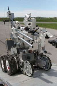 A bomb disposal robot drives up a ramp piloted  by New York Army National Guard Staff Sgt. Adam Russ of the New York Army National Guard's 501st Explosive Ordnance Disposal (EOD) Battalion, during training at the New York State Preparedness Training Center in Oriskany New York, May 18.  New York Army National Guardsmen trained for a week alongside domestic and international EOD military and law enforcement personnel during an exercise called Raven's Challenge , May 16-20, sponsored by the New York State Division of Homeland Security and Emergency Services. (U.S. Army National Guard Photo by Sgt. J.p. Lawrence/Released).