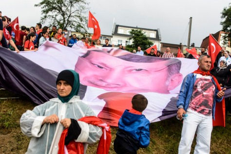 Erdogan flags and posters seen around the demonstration